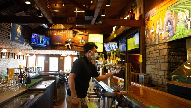 David Delgaldillo, bartender at The Blind Tiger Brewery & Restaurant, cleans the taps Thursday afternoon. The Blind Tiger is celebrating its 25th anniversary this weekend with a special throwback menu and beer for the occasion.