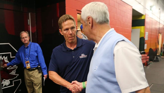 Gonzaga head basketball coach Mark Few (left) and North Carolina head basketball coach Roy Williams shake hands while walking in the tunnels at University of Phoenix Stadium in Glendale on Sunday, April 2, 2017.  Gonzaga plays North Carolina in the NCAA national championship game.