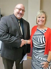 Ozark Superintendent Kevin Patterson and school board president Patty Quessenberry in a March 27, 2017 photo.