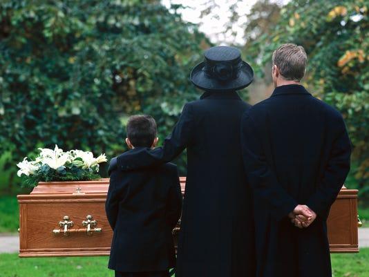 635863195619552345-ex-funeral.jpg