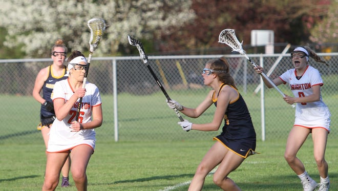Hannah Kelley (26) scored five goals for Brighton in a 16-14 victory over Bloomfield Hills in the state lacrosse semifinals.