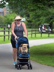 Karen Horrocks walks with her dog, Rubee, at the Richland