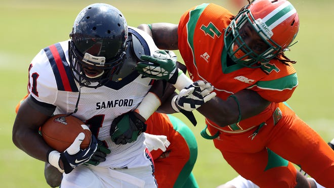 Terry Johnson, right, knocks Samford's ball carrier Kelsey Pope out of bounds during their game two seasons ago. Johnson is the only senior in the Rattlers' secondary this season.