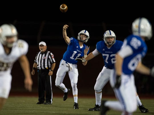Memorial's Michael Lindauer (11) makes a pass during Memorial's game against the Central Bears at Enlow Field in Evansville, Ind., on Friday, Sept. 29, 2017. Central won 35-7.