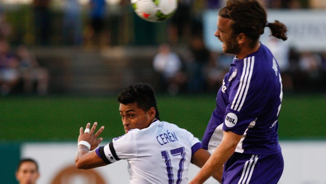 Louisville City's Matt Fondy, #9, right, shoots the ball against Orlando City's Darwin CerŽn, #17, during their game at Slugger Field.  He did not socre on this play, but scored later in the game.Aug. 25, 2015