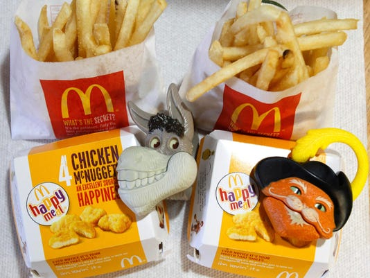 """Two McDonald's Happy Meal with toy watches fashioned after the characters Donkey and Puss in Boots from the movie """"Shrek Forever After"""" are pictured in Los Angeles"""