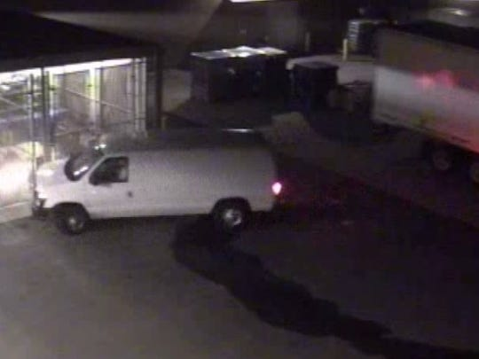 Image from surveillance video shows the Ford Econoline van driven by the suspects in the theft of batteries from the Dickson Walmart.