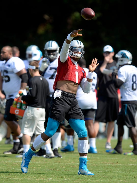 Carolina Panthers' Cam Newton (1) makes a pass during NFL football training camp in Spartanburg, S.C., Wednesday, Aug. 6, 2014. (AP Photo/The Charlotte Observer, David t. Foster III ) MAGS OUT; TV OUT; NEWSPAPER INTERNET ONLY