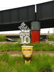 "One of two golden ""Take a Trump"" toilets that popped"