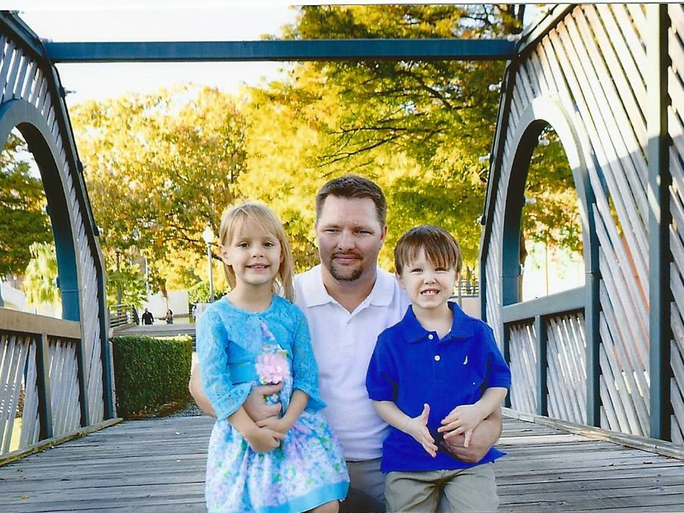 Steven Forrest with his son and daughter.