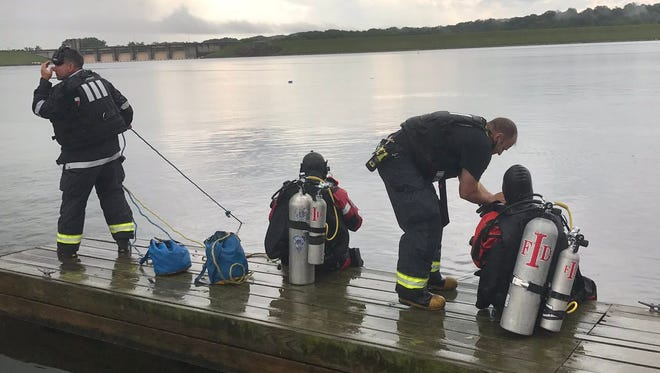 Indianapolis Fire Department divers rescued a male from about 30 feet of water off a dock at Rick's Boatyard Cafe near Eagle Creek Friday, June 30, 2017.