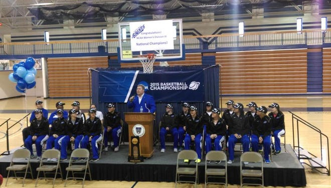 Thomas More College President David A. Armstrong addresses gathered fans in Crestview Hills Sunday.