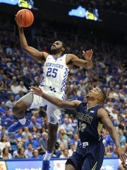UK's Dominique Hawkins (25) beats Clarion's Justin Dobbs (52) to the basket during their game at Rupp Arena.Oct. 30, 2016