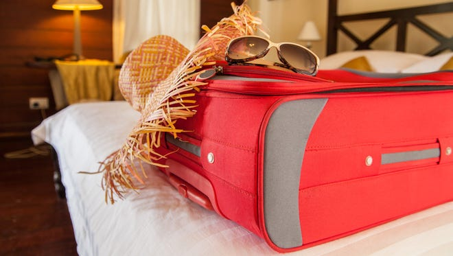 a luggage and beach gears on the resort bed