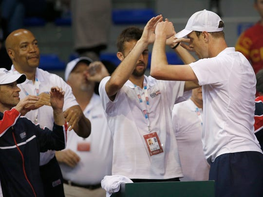 United States' Sam Querrey, right, celebrates with teammates after defeating Serbia's Laslo Djere during their Davis Cup World group first round tennis match in Nis, Serbia, Friday, Feb. 2, 2018. (AP Photo/Darko Vojinovic)