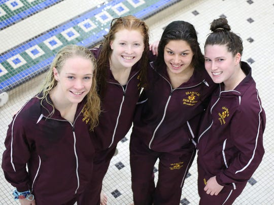 Seaholm's 200-yard medley teal team of (left to right) Haley Dolan, (freestyle)  Linnea Anderson, (butterfly), Lexi Greenberger (backstroke) and Gigi Hoppen, (breaststroke) earned All-League honors by swimming to first place in the OAA Red Division championship meet.