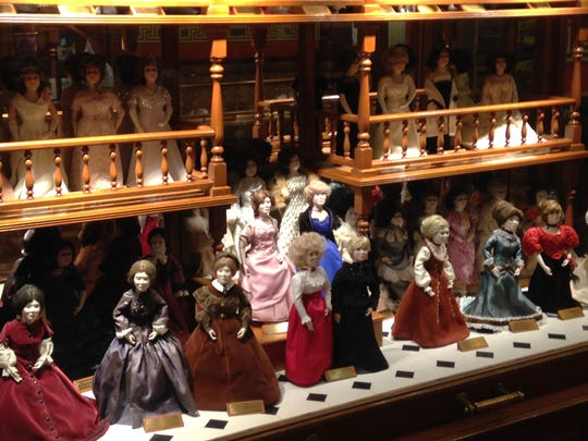 Dolls of all the Iowa first ladies wearing their inaugural