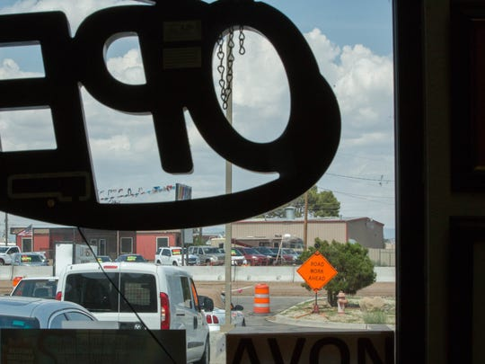 Looking out from La Fiesta Bakery on to North Valley Drive, where all entrances to the shopping center are blocked. Customers must enter the shopping center from Archuleta Road. Tuesday July 31, 2018.