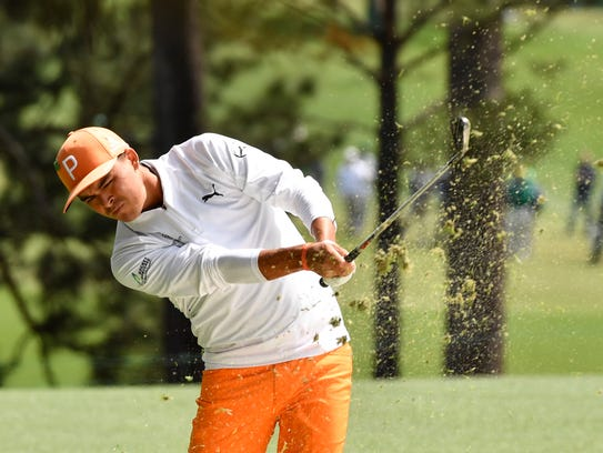Rickie Fowler hits from the fairway on the 1st hole