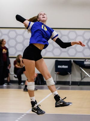 Mukwonago junior Alayna Jansky (15) elevates for a kill during a match against Howards Grove in the Mizuno Charger Rally at the Milwaukee Sting Center on Saturday, Sept. 16, 2017.