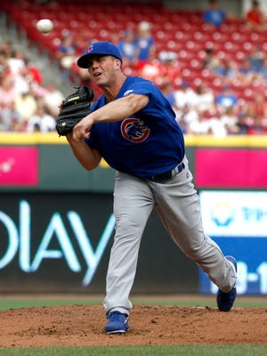 Lafayette's Clayton Richard, shown here pitching for the Chicago Cubs earlier this month, debuted with the Triple-A Iowa Cubs on Tuesday night.