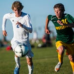Aaron Constantino, left, and Kolby Hannah, right, race to take control of the ball during the boy's crosstown soccer game at Siebel Soccer Complex Tuesday, Sept. 29, 2015.
