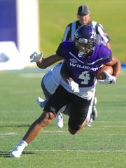 Joey D. Richards/Reporter-News Abilene Christian receiver Vasquez Haynes (4) tries to shake Central Arkansas' Tavion Garrison after catching a pass from Parker McKenzie in the third quarter. The play went for 27 yards on a third-and-9 play from the ACU 47. Tracy James capped the drive with a 1-yard TD run to UCA's lead to 44-20 with 3:43 left in the third quarter. The Bears beat ACU 58-27 in the Southland Conference game Saturday, Oct. 2, 2016 at Shotwell Stadium.
