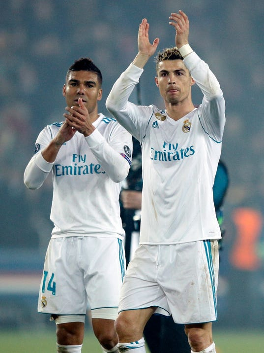 Real Madrid's scorers Casemiro, left, and Cristiano Ronaldo wave to their fans after the round of 16, 2nd leg Champions League soccer match between Paris Saint-Germain and Real Madrid at the Parc des Princes Stadium in Paris, Tuesday, March 6, 2018. Real Madrid won 2-1.(AP Photo/Francois Mori)