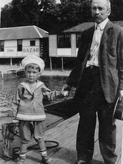 Alonzo d'Orsay on the dock near their cottage with grandson Jules d'Orsay Holmes, who would marry Lucy, 90-year-old current owner of the home.