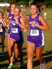 Portland High junior Leighanne Simmons (1110) and freshman Josie Jones (1114) run together in the early portion of Tuesday's race. Jones finished 21st, while Simmons placed 53rd.