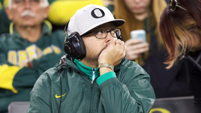 Sep 26, 2015; Eugene, OR, USA; Oregon Ducks fan looks to the score board following a against the Utah Utes touchdown at Autzen Stadium. Mandatory Credit: Scott Olmos-USA TODAY Sports