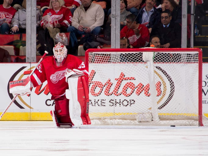 Detroit goalie Jimmy Howard sits in front of the net