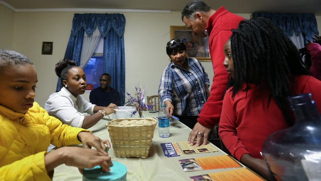 Ja'Mya Jackson, 10, left, Kiria James, 16 and Kessiah James, 9, sell raffle tickets and take donations for the Stop The Violence Prayer Chain Foundation Thursday in Wilmington.