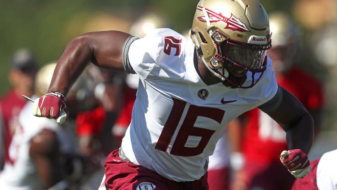 FSU's Tre' McKitty works out during their opening practice for fall camp at the Al Dunlap Training Facility Monday, Aug. 6, 2018.