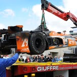 Andretti Autosport's Simona de Silvestro (29) burnt up car is dropped off in her garage area after her car caught fire during practice for the Indianapolis 500, May 12, at the Indianapolis Motor Speedway.