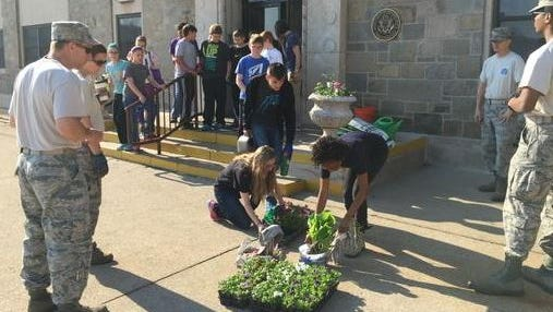 Students at St. Peter's get ready to go to work with members of the National Guard to beautify the area.