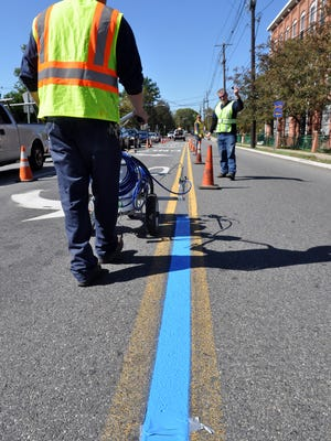 Little Falls DPW workers painting blue lines on union Avenue, Main Street and Montclair Avenue on three sides of the municipal building. Towns all over all coming together doing the same to show support towards their police officers.