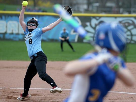 Bishop Kearney's Emily Phelan (8) pitches against Irondequoit.