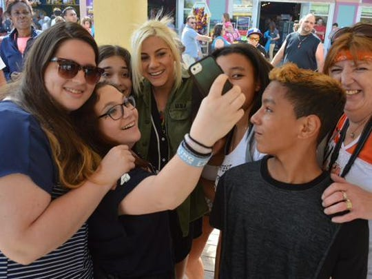 Members of the Jax Pack take selfies with Jax on the Point Pleasant Beach boardwalk.