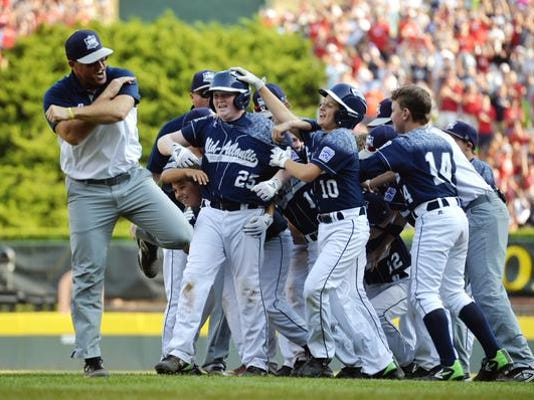 Red Land Little League players celebrate after winning the United States championship against Pearland, Texas, 3-2 in the Little League World Series on Saturday, August 29, 2015.