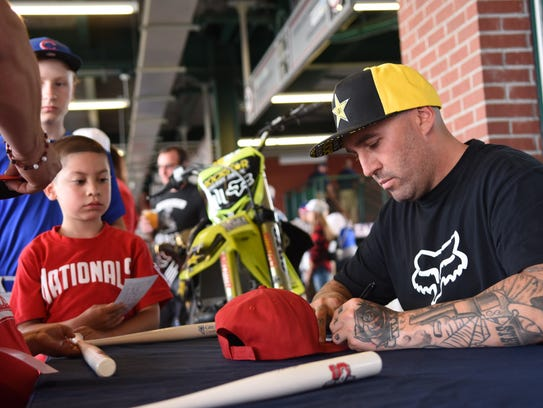Mike Mason signs autographs at Greater Nevada Field