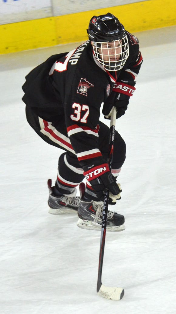 St. Cloud State's Joey Rehkamp carries the puck Friday