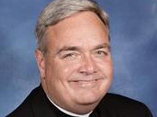 Rev. Robert J. Fisher