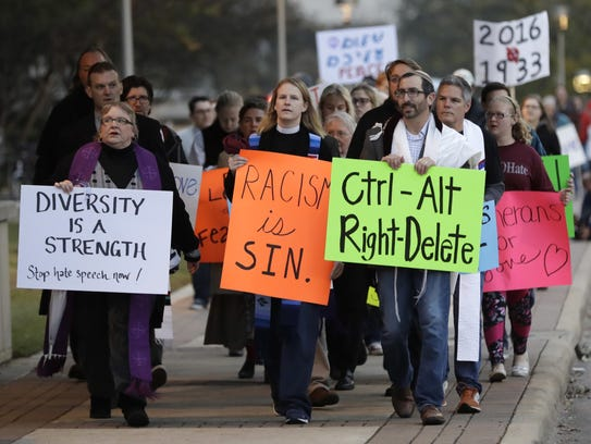 Demonstrators gather outside the venue at Texas A&M