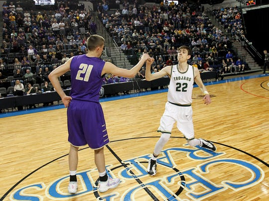 Muscatine's Joe Wieskamp, left, and West High's Patrick McCaffery, both Iowa commits, wish each other luck prior to their game at the U.S. Cellular Center in Cedar Rapids on Tuesday.