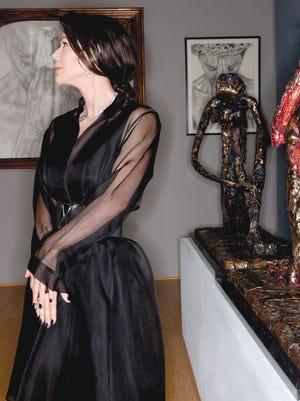 Gesso Cocteau strikes a John Singer Sargent pose in a black Luna Luz silk/organza ensemble.