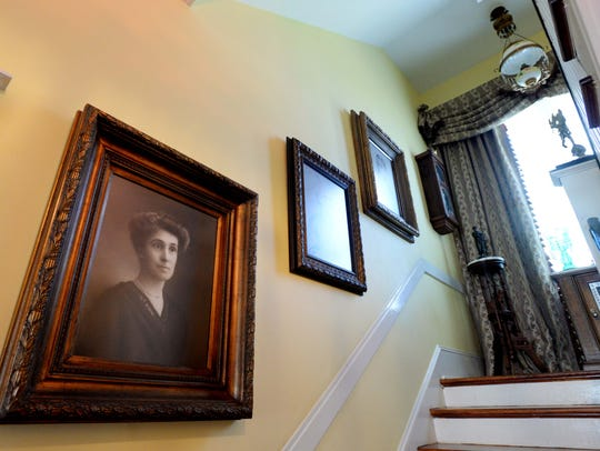 Photos of well-known Shreveport people line the stairs