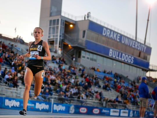 Former Dowling Catholic star Karissa Schweitzer of Missouri wins the women's 5,000 meter at the Drake Relays on Thursday, April 26, 2018.