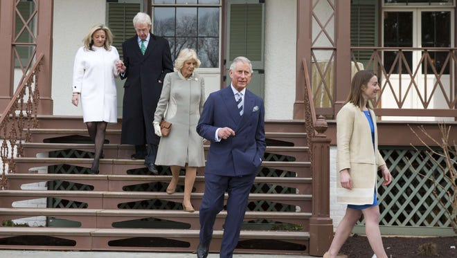Britain's Prince Charles  and wife Camilla, Duchess of Cornwall, center, tour Lincoln's Cottage at the Soldiers' Home in Washington, D.C.
