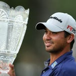 Jason Day, of Australia, holds up a trophy after winning The Barclays golf tournament Sunday, Aug. 30, 2015, in Edison, N.J. (AP Photo/Adam Hunger)
